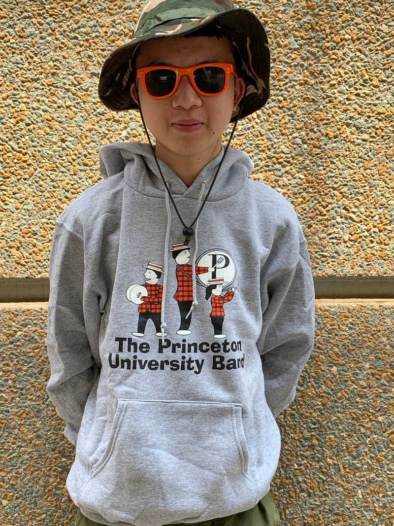 Gray sweatshirt with band logo of people playing instruments